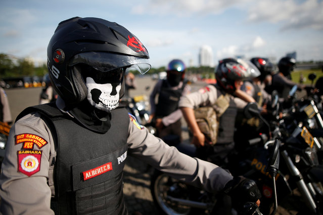 Indonesian police prepare to leave on motorcycles after attending a security briefing at the National Monument before deployment during the Christmas and New Year holidays in Jakarta, Indonesia December 22, 2016. (Photo by Darren Whiteside/Reuters)