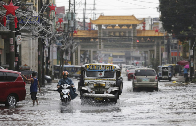 A passenger jeep navigates a flooded street caused by rains from Typhoon Nock-Ten in Quezon city, north of Manila, Philippines on Monday, December 26, 2016. (Photo by Aaron Favila/AP Photo)