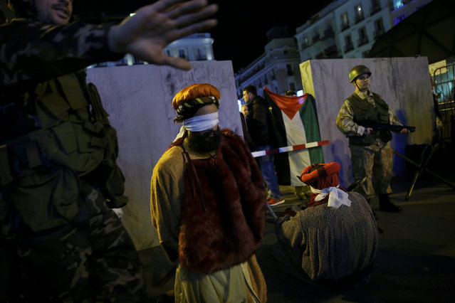 Demonstrators dressed as the Three Wise Men are detained at a mock Israeli checkpoint in the West Bank city of Bethlehem as part of a protest by Pro-Palestine supporters in Madrid, Spain, December 27, 2016. (Photo by Susana Vera/Reuters)