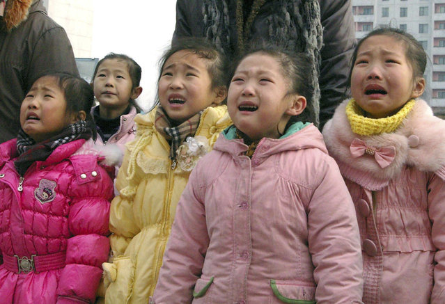 North Koreans mourn their deceased leader Kim Jong-il in Pyongyang December 27, 2011. (Photo by Reuters/KCNA)