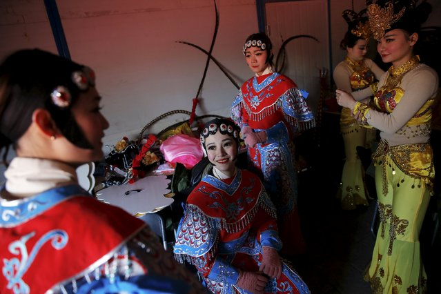 Performers get ready to go onto the stage as the Lunar New Year of the Monkey is celebrated at the temple fair at Ditan Park (the Temple of Earth) in Beijing, China, February 8, 2016. (Photo by Damir Sagolj/Reuters)