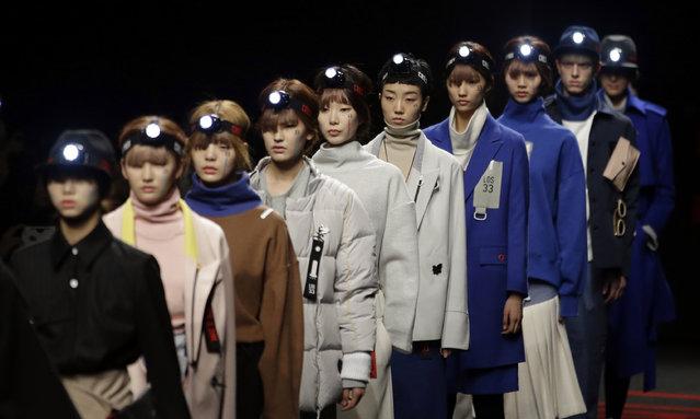 Models display creation by South Korean fashion designer Hongbum Kim during the 2015 fall/winter show at the Seoul Fashion Week in Seoul, South Korea, Tuesday, March 24, 2015. (Photo by Lee Jin-man/AP Photo)