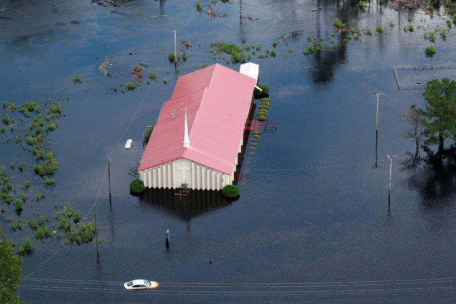 The Rock Hill Missionary Baptist Church is seen in floodwater caused by Hurricane Florence, in this aerial picture, in Lumberton, North Carolina, U.S. September 17, 2018. (Photo by Jason Miczek/Reuters)
