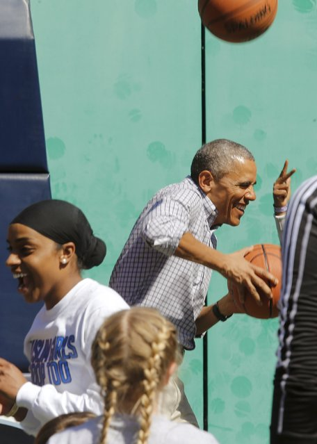 U.S. President Barack Obama reacts to getting hit on the head by a rebound while playing basketball, an exercise activity during the annual Easter Egg Roll at the White House in Washington April 6, 2015. (Photo by Jonathan Ernst/Reuters)