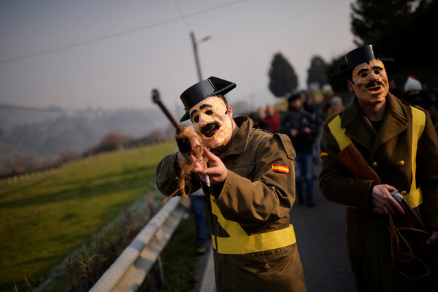 """A reveller dressed as a Spanish Civil Guard aims his gun during """"La Vijanera"""", a winter masquerade at the beginning of carnival season in Europe, in Silio, northern Spain, January 8, 2017. (Photo by Vincent West/Reuters)"""