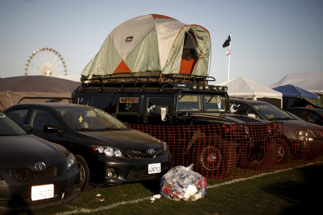 A Hummer with a tent on the roof is seen in the car camping area at the Coachella Valley Music and Arts Festival in Indio, California April 11, 2015. (Photo by Lucy Nicholson/Reuters)