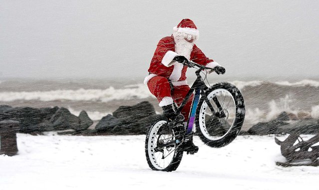 Santa Claus rides a 2014 Salsa Beargrease fat bike at Canal Park in Duluth, Minnesota. (Photo by Clint Austin/Duluth News Tribune/MCT)