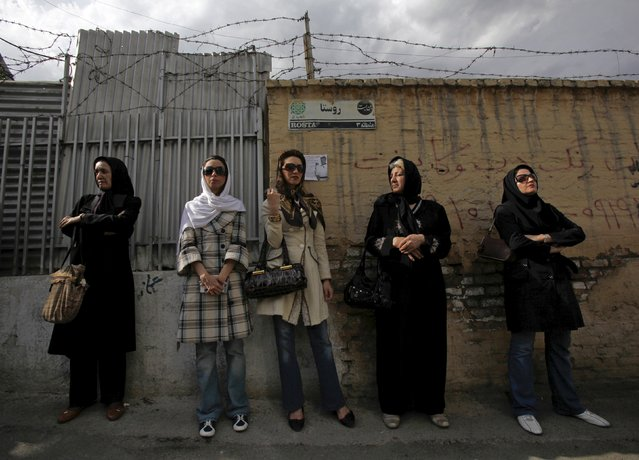 Iranian women wait in line outside a polling station during the Iranian presidential election in Tehran, in this June 12, 2009 file photo. (Photo by Ahmed Jadallah/Reuters)