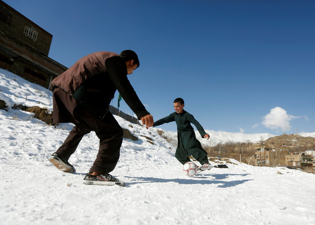 Boys play football on a field covered in snow on the outskirts of Kabul, Afghanistan January 6, 2017. (Photo by Omar Sobhani/Reuters)