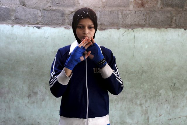 Azmeena, 16, takes part in warm up exercises at the first women's boxing coaching camp in Karachi, Pakistan February 19, 2016. (Photo by Akhtar Soomro/Reuters)
