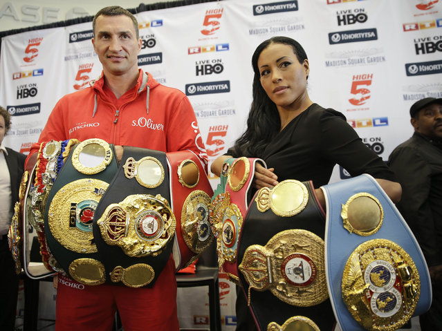 Boxers Wladimir Klitschko, left, and Cecilia Braekhus pose for pictures with their title belts during a news conference in New York, Tuesday, April 21, 2015. (Photo by Seth Wenig/AP Photo)