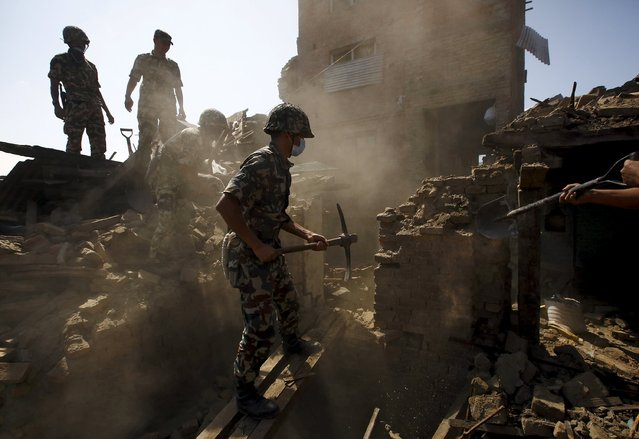 Nepalese army personnel search for victims trapped inside collapsed buildings following Saturday's earthquake in Bhaktapur, Nepal April 27, 2015. (Photo by Navesh Chitrakar/Reuters)