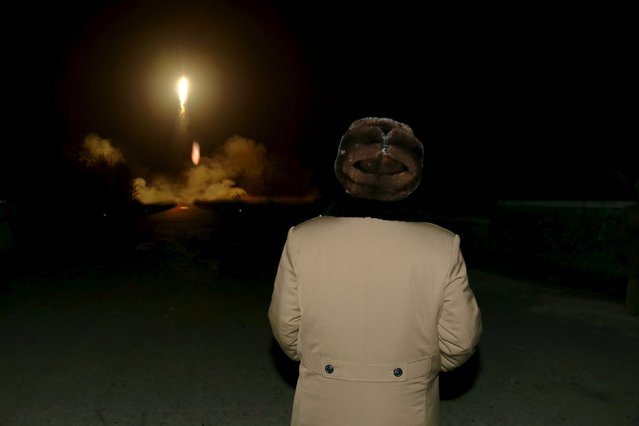 North Korean leader Kim Jong Un watches the ballistic rocket launch drill of the Strategic Force of the Korean People's Army (KPA) at an unknown location, in this undated photo released by North Korea's Korean Central News Agency (KCNA) in Pyongyang on March 11, 2016. (Photo by Reuters/KCNA)