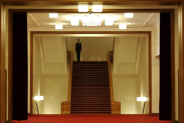 A security officer stands guard after the third plenary session of the National People's Congress (NPC) at the Great Hall of the People, in Beijing, China, March 13, 2016. (Photo by Kim Kyung-hoon/Reuters)