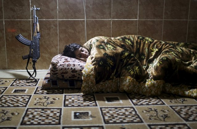 A female Kurdistan Workers Party (PKK) fighter sleeps at a base in Sinjar, March 11, 2015. (Photo by Asmaa Waguih/Reuters)