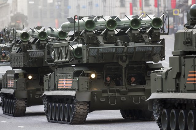 Russian military vehicles make their way to Red Square during a rehearsal for the Victory Day military parade which will take place at Moscow's Red Square on May 9 to celebrate 70 years after the victory in WWII, in Moscow, Russia, Monday, May 4, 2015. (Photo by Alexander Zemlianichenko/AP Photo)