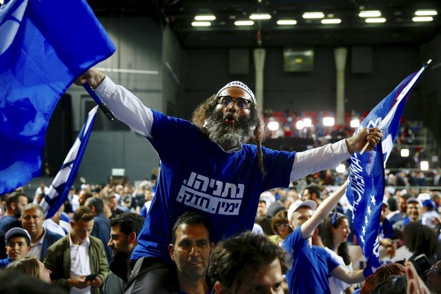 Likud party supporters cheer at the party's campaign headquarters after polls for Israel's general elections closed in Tel Aviv, Israel, Wednesday, April 10, 2019. (Photo by Ariel Schalit/AP Photo)