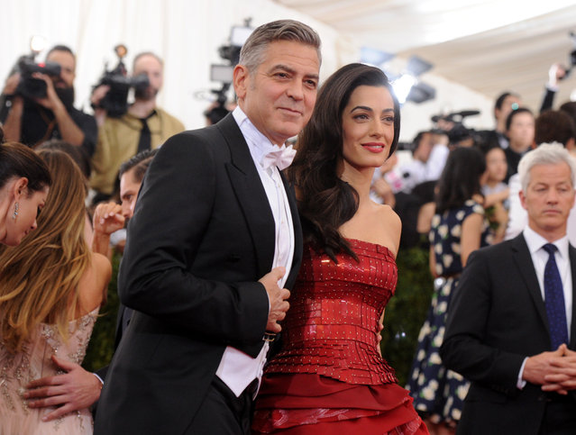 "George Clooney and Amal Clooney arrive at The Metropolitan Museum of Art's Costume Institute benefit gala celebrating ""China: Through the Looking Glass"" on Monday, May 4, 2015, in New York. (Photo by Evan Agostini/Invision/AP Photo)"