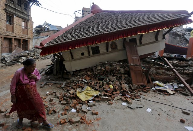 An earthquake victim walks past a collapsed temple in Sankhu, on the outskirts of Kathmandu, May 2, 2015. (Photo by Adnan Abidi/Reuters)