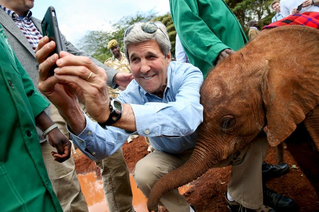 U.S. Secretary of State John Kerry takes a selfie with a baby elephant while touring the Sheldrick Center Elephant Orphanage at the Nairobi National Park, Sunday, May 3, 2015, in Nairobi, Kenya. (Photo by Andrew Harnik/Reuters)