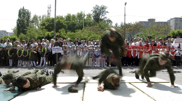 Children watch the performance of members of a youth military patriotic club during the so-called parade of children's troops in Rostov-on-Don, southern Russia, May 14, 2015. (Photo by Eduard Korniyenko/Reuters)