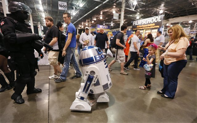 An R2-D2 droid tours the Motor City Comic Con at the Suburban Collection Showcase, Friday, May 15, 2015, in Novi, Mich. The three-day pop-culture extravaganza will welcome dozens of celebrities from the worlds of TV, film and beyond as well as thousands of fans. (AP Photo/Carlos Osorio)