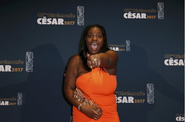 """Actress Deborah Lukumuena reacts during a photocall after receiving the Best Supporting Actress Award for her role in the film """"Divines"""" at the 42nd Cesar Awards ceremony in Paris, France, February 24, 2017. (Photo by Gonzalo Fuentes/Reuters)"""