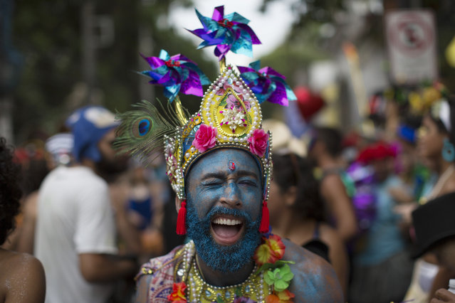 """A reveler reacts to the camera as he performs during the """"Ceu na Terra"""" or Heaven on Earth street party in Rio de Janeiro, Brazil, Saturday, February 25, 2017. Merrymakers take to the streets in hundreds of open-air """"bloco"""" parties during Rio's over-the-top Carnival, the highlight of the year for many. (Photo by Leo Correa/AP Photo)"""