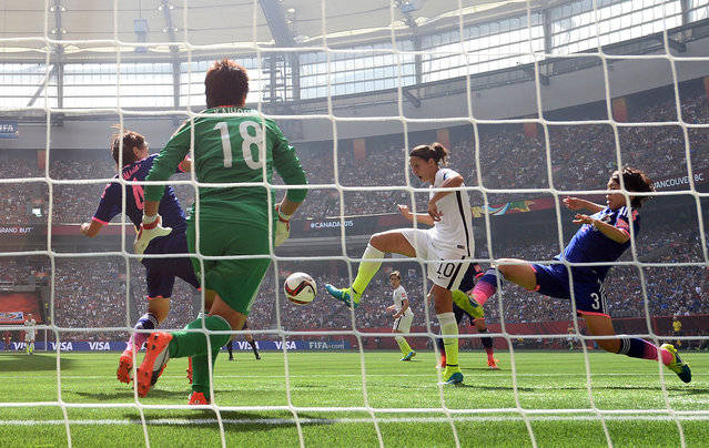 Carli Lloyd #10 of the United States of America scores the team's second goal against Saki Kumagai #4, Azusa Iwashimizu #3 and goalkeeper Ayumi Kaihori #18 of Japan in the FIFA Women's World Cup Canada 2015 Final at BC Place Stadium on July 5, 2015 in Vancouver, Canada.  (Photo by Dennis Grombkowski/Getty Images)