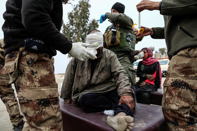 A man injured in a mortar attack is treated by medics in a field clinic as Iraqi forces battle with Islamic State militants, in western Mosul, Iraq March 2, 2017. (Photo by Zohra Bensemra/Reuters)