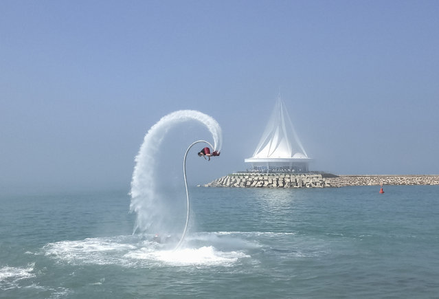 A man performs at the opening ceremony of a yacht club, which is part of the Avaza resort, on the Caspian Sea in western Turkmenistan June 29, 2013. (Photo by Marat Gurt/Reuters)