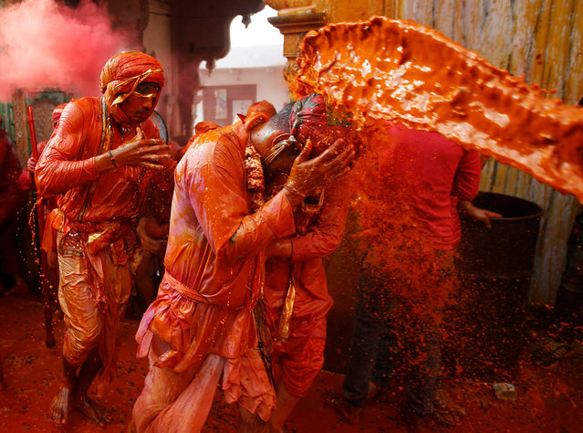 Hindu devotees take part in the religious festival of Holi in Nandgaon village, in the state of Uttar Pradesh, India March 7, 2017. (Photo by Adnan Abidi/Reuters)