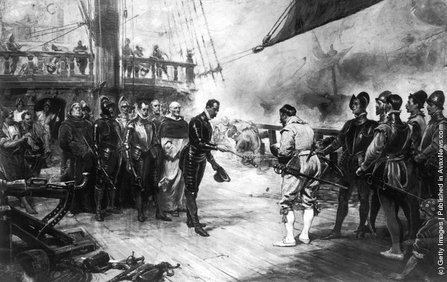 Don Pedro de Valdes, Admiral of the Spanish flagship Nuestra Senora del Rosario, surrenders his sword to Sir Francis Drake (c.1540 - 1596) of the British navy on board the HMS Revenge in the English Channel, 1588. A painting by Seymour Lucas