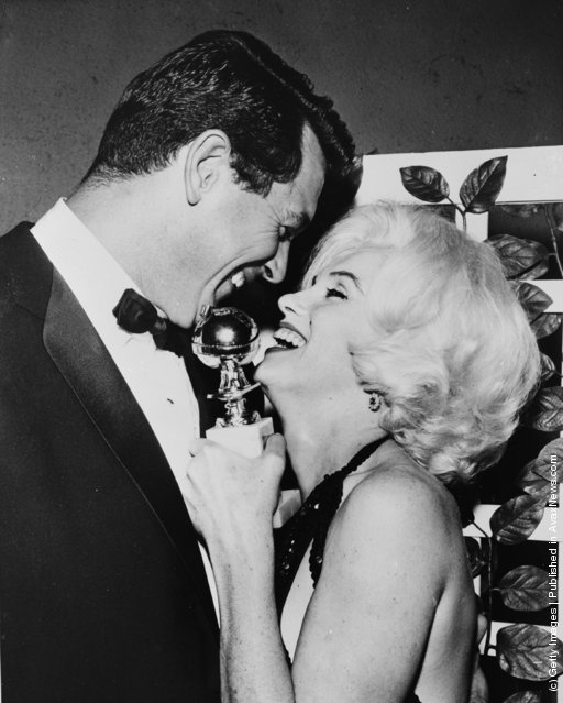 1962: Marilyn Monroe receives her Golden Globe award from Rock Hudson (1925 - 1985) at the Hollywood Foreign Press Association's 19th Annual Dinner