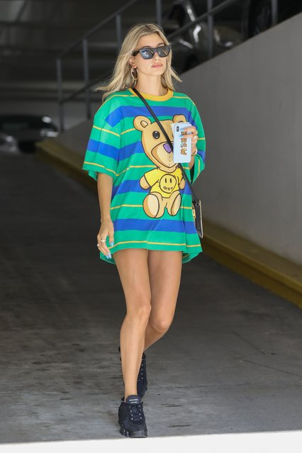 Hailey Baldwin is a super supportive wife as she steps out in Beverly Hills Wednesday, August 7, 2019, sporting one of hubby Justin Bieber's Drew House designs featuring a teddy bear. The 22-year-old model shows off her slender legs as she helps promote Justin's growing brand. (Photo by Juliano/X17online.com)