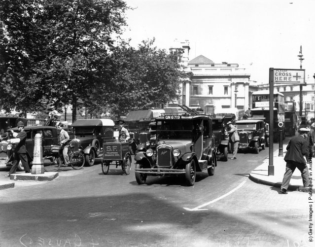 1932: A policeman directs traffic in London's Trafalgar Square