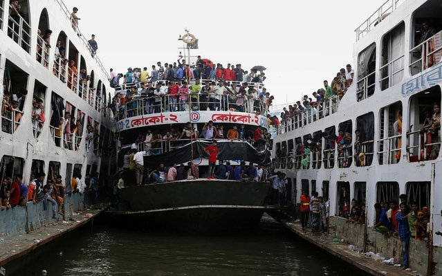 Bangladeshi homebound passengers gather on ferries as they travel to their villages to celebrate of Eid-al-Adha festival, at Sadarghat launch terminal in Dhaka, Bangladesh, 10 August 2019. Eid al-Adha is the holiest of the two Muslims holidays celebrated each year, it marks the yearly Muslim pilgrimage (Hajj) to visit Mecca, the holiest place in Islam. Muslims slaughter a sacrificial animal and split the meat into three parts, one for the family, one for friends and relatives, and one for the poor and needy. (Photo by Monirul Alam/EPA/EFE/Rex Features/Shutterstock)