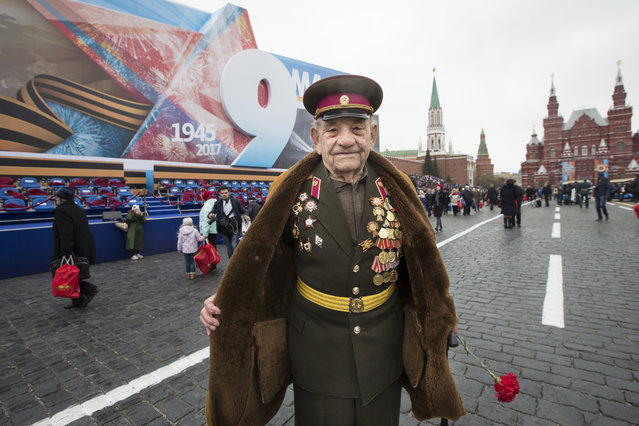 WWII veteran Alexei Marchenkov, 94, poses for a photo at the Red Square during the Victory Day military parade to celebrate 72 years since the end of WWII and the defeat of Nazi Germany, in Moscow, Russia, on Tuesday, May 9, 2017. Marchenkov went to a front on July 12, 1941 in the Soviet Union and finished his service on Sept. 2, 1945 at Far East. (Photo by Alexander Zemlianichenko/AP Photo)