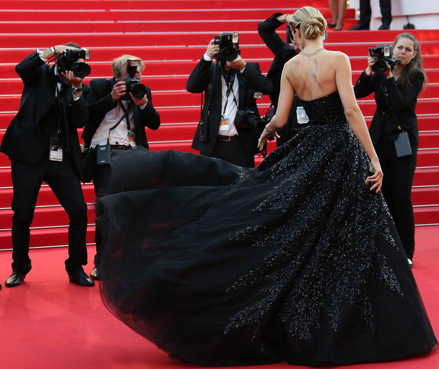"""Czech model Petra Nemcova poses as she arrives for the screening of the film """"Deux Jours, Une Nuit"""" (Two Days, One Night) at the 67th edition of the Cannes Film Festival in Cannes, southern France, on May 20, 2014. (Photo by Loic Venance/AFP Photo)"""
