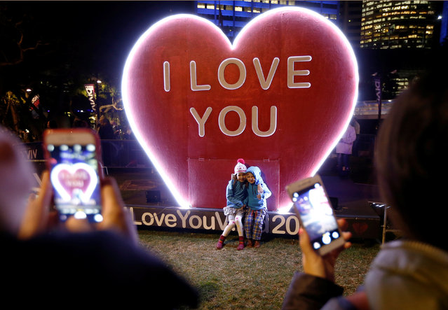Children have their picture taken in front of an 'I Love You' installation during the opening night of the annual Vivid Sydney light festival in Sydney, Australia May 27, 2016. (Photo by Jason Reed/Reuters)
