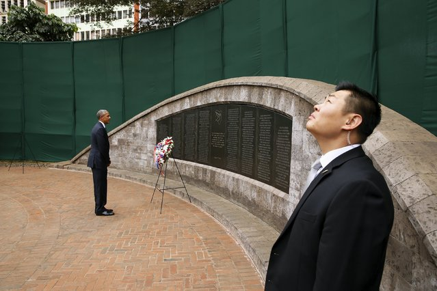A Secret Service agent (R) keeps watch as U.S. President Barack Obama (L) lays a wreath at Memorial Park on the former site of the U.S. Embassy, where al Qaeda bombed the compound in 1998 killing more than 200 people, in Nairobi July 25, 2015. (Photo by Jonathan Ernst/Reuters)
