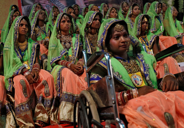 Brides wait during a mass wedding ceremony organised for underprivileged and physically challenged couples in Mumbai, India, May 29, 2016. (Photo by Danish Siddiqui/Reuters)