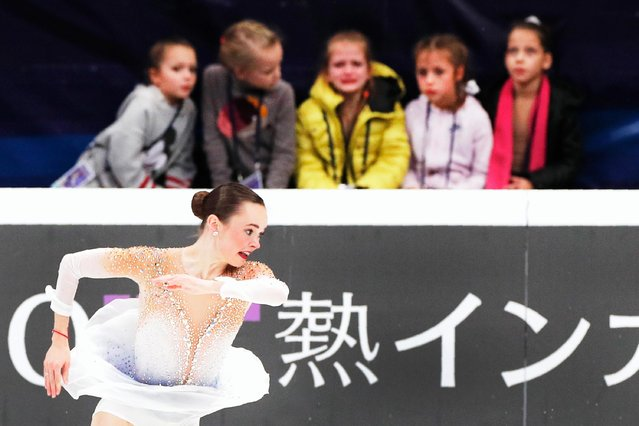 Children watch Mariah Bell of the United States perform her ladies free skating routine at the ISU Grand Prix of Figure Skating- Rostelecom Cup in Moscow, Russia, Saturday, November 16, 2019. (Photo by Alexander Zemlianichenko/AP Photo)