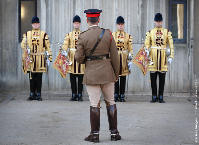 An officer (C) inspects The State Trumpeters of The Household Cavalry Mounted Regiment (HCMR) during parade at Hyde Park Barracks