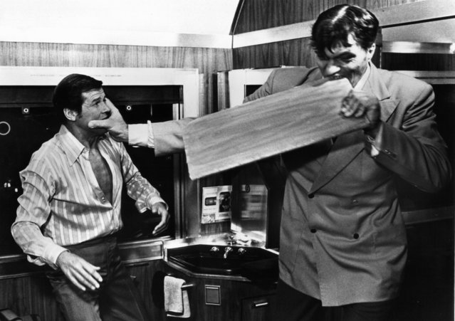 "Roger Moore fights with Richard Kiel, as Jaws, who bites through a board in a scene from the film ""The Spy Who Loved Me"", 1977. (Photo by United Artist/Getty Images)"