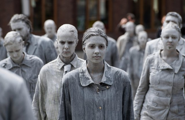 """Prostestors dressed-up in grey clothes like Zombies attend a arts performance called """"1000 Gestalten"""" demonstration prior the upcoming G20 summit in Hamburg, northern Germany, 05 July 2017. The G20 Summit (or G-20 or Group of Twenty) is an international forum for governments from 20 major economies. The summit is taking place in Hamburg 07 to 08 July 2017. (Photo by Lukas Barth-Tuttas/EPA)"""