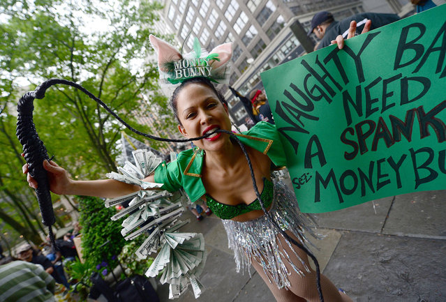 Occupy Wall Street partcipants gather to stage a May Day demonstration march at Bryant Park in New York