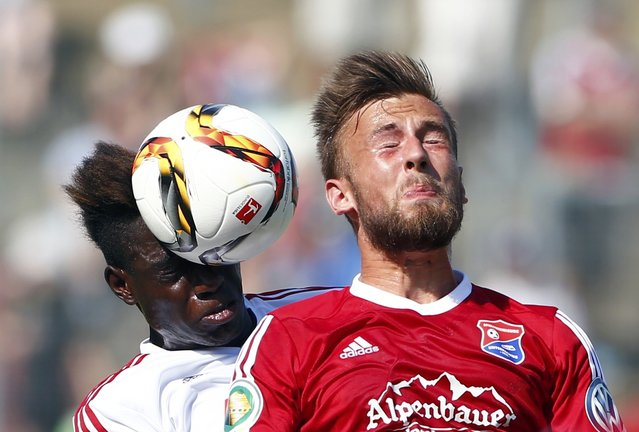 Danny Da Costa of FC Ingolstadt challenges Dominic Reisner of Unterhaching (R) during their German Cup (DFB Pokal) first round soccer match in Unterhaching, Germany August 9, 2015. (Photo by Michaela Rehle/Reuters)