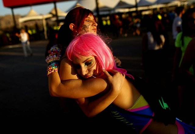 Justine Marsing, right, embraces Andrea Martinez at the Electric Daisy Carnival at the Las Vegas Motor Speedway on June 8, 2012