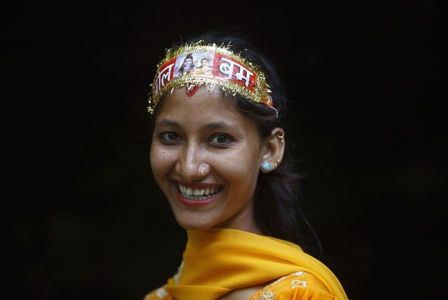 "A Hindu devotee wears a headband with the words ""Bol Bom"" (Say Shiva) while participating in the ""Bol Bom"" pilgrimage in Kathmandu July 21, 2014. The faithful, chanting the name of Lord Shiva, run about 15 km (9 miles) barefooted toward Pashupatinath temple seeking good health, wealth and happiness. (Photo by Navesh Chitrakar/Reuters)"